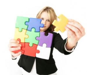 Girl holding puzzle piece.