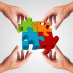 Picture of hands holding puzzle,